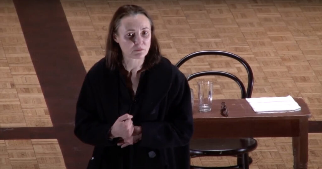 """Photo of Simona Giurgea performing Weil's """"Iliad, or Poem of Force"""" essay"""